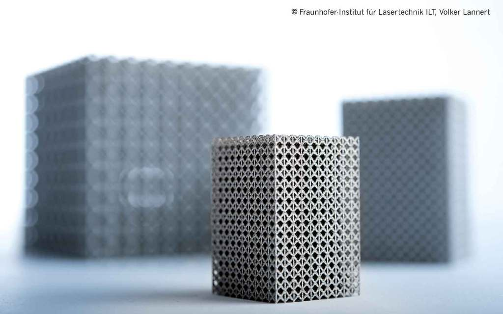 Metal sample component with a concave grating structure manufactured through the Selective Laser Melting (SLM) method developed and patented at the Fraunhofer ILT.